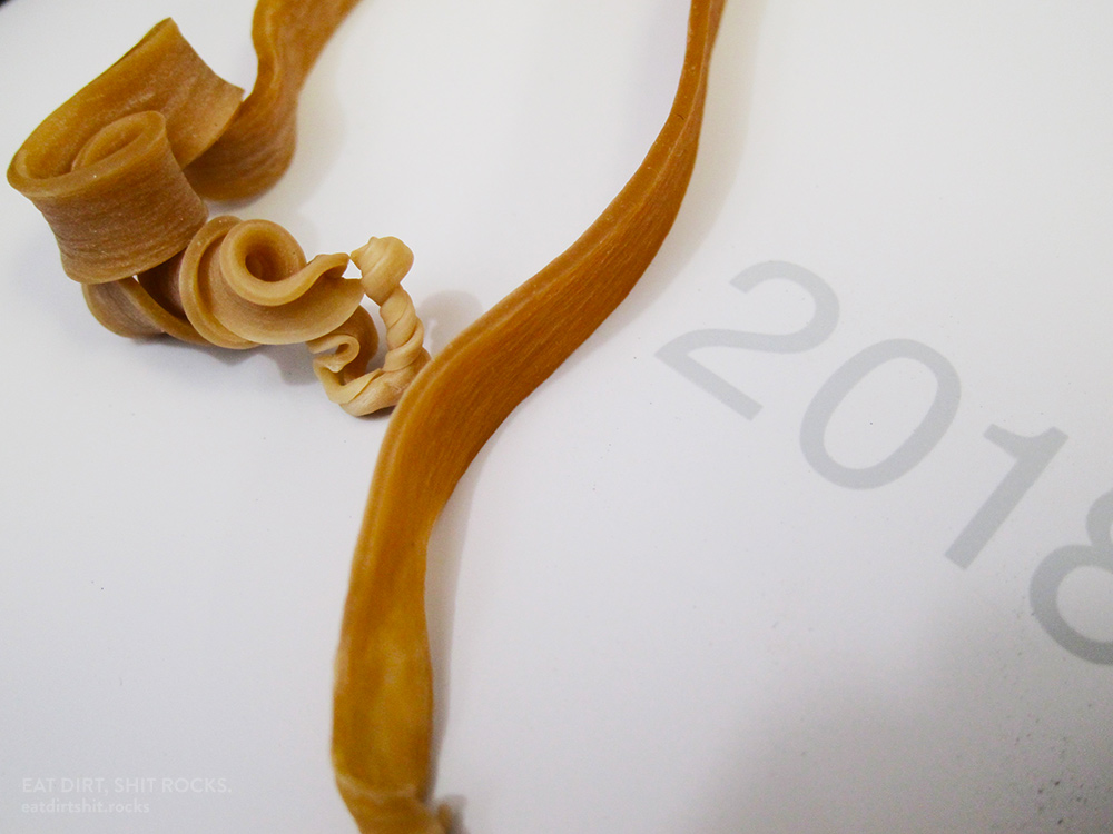 Interestingly-snapped rubber band.