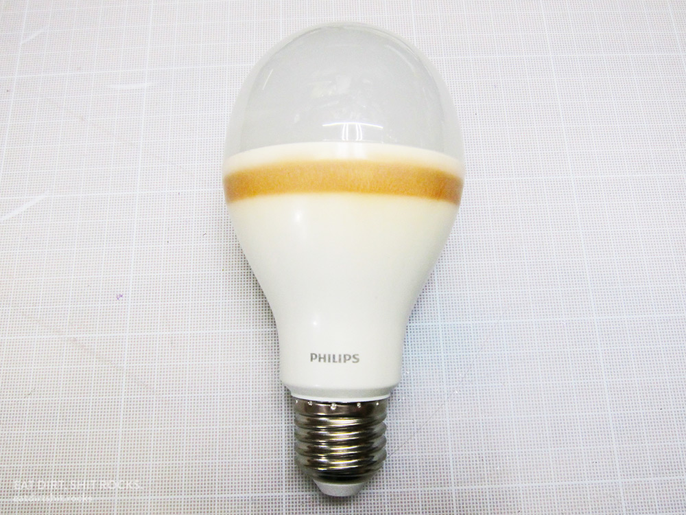 Flickering LED bulb boasting a urine-stain-yellow ring of death.