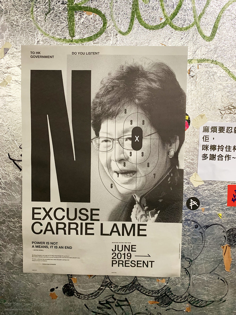 We saw this poster in the elevator from street level to the This Town Needs live music venue in Yau Tong.