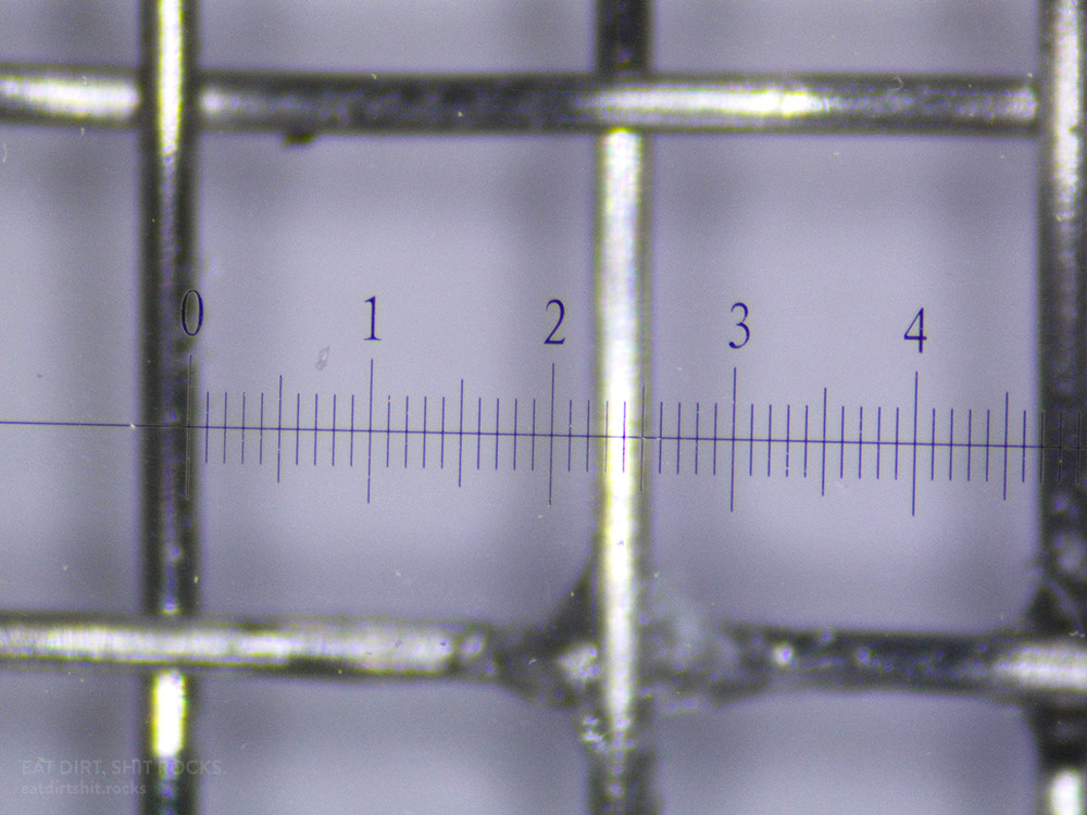 This is a microscope photo of the grade of mesh I used for this experiment: grade-10 mesh with 2.3mm-square holes.